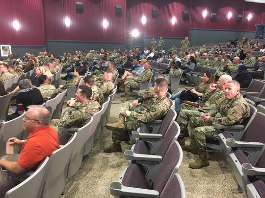 Soldiers and spouses gather for the town hall meeting at Fort Campbell's Wilson Theater.