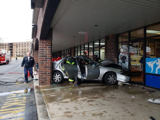 Car strikes martial arts studio at Inman Grove shopping center in Edison