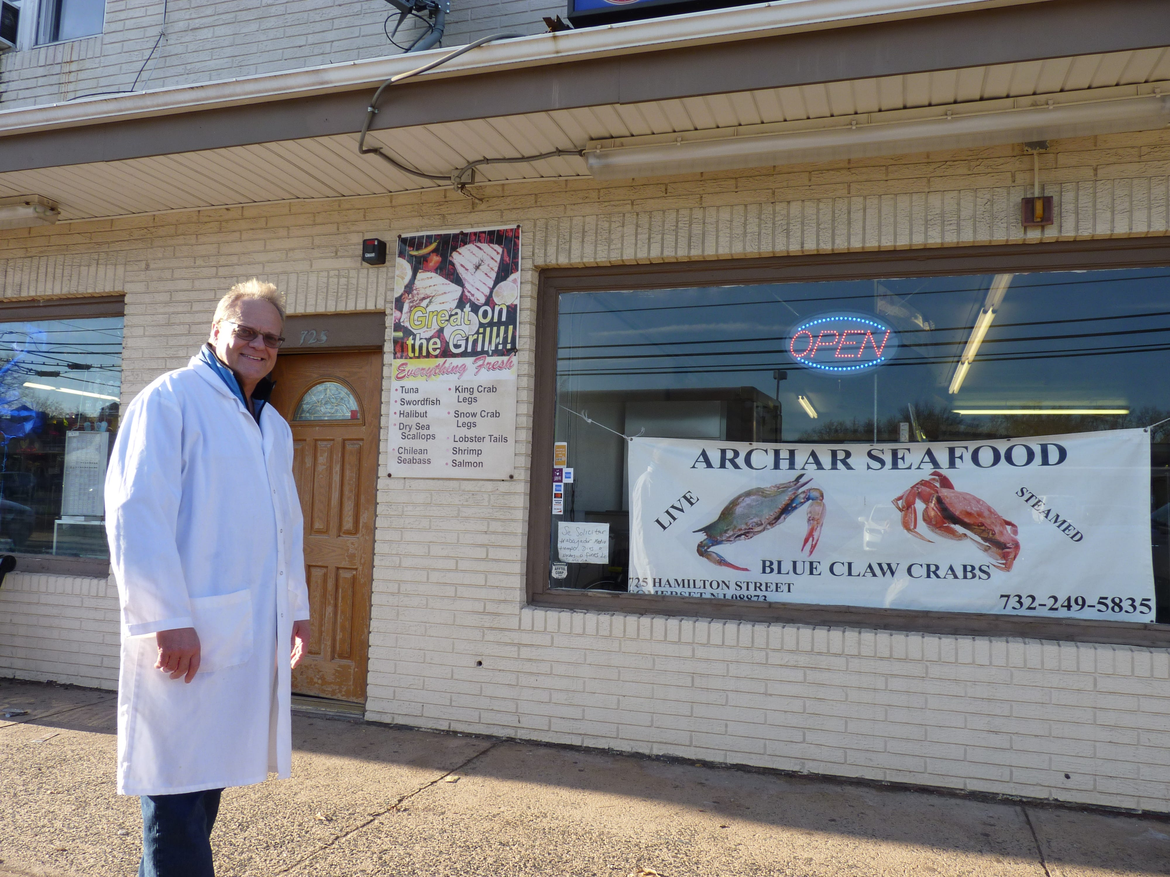 Michael Zabawsky, owner of Archar Seafood, standing outside of his shop on Hamilton Street in Somerset.
