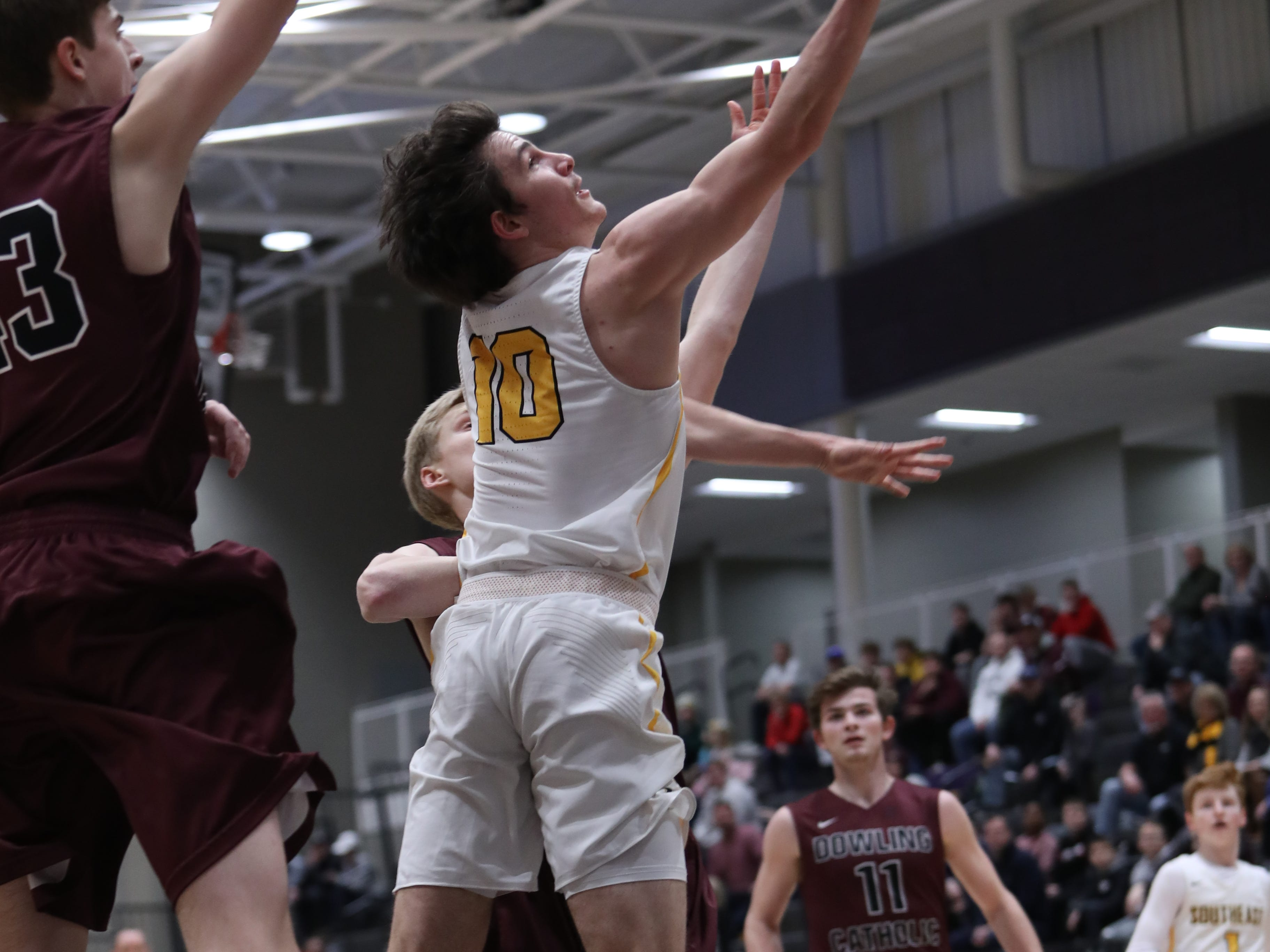 Southeast Polk's Daniel Hackbarth (10) goes back-door against Dowling Catholic during their game at Johnston High School in Johnston, Iowa, on Tuesday, Feb. 26, 2019. Dowling won the game 44-40 to advance to state.