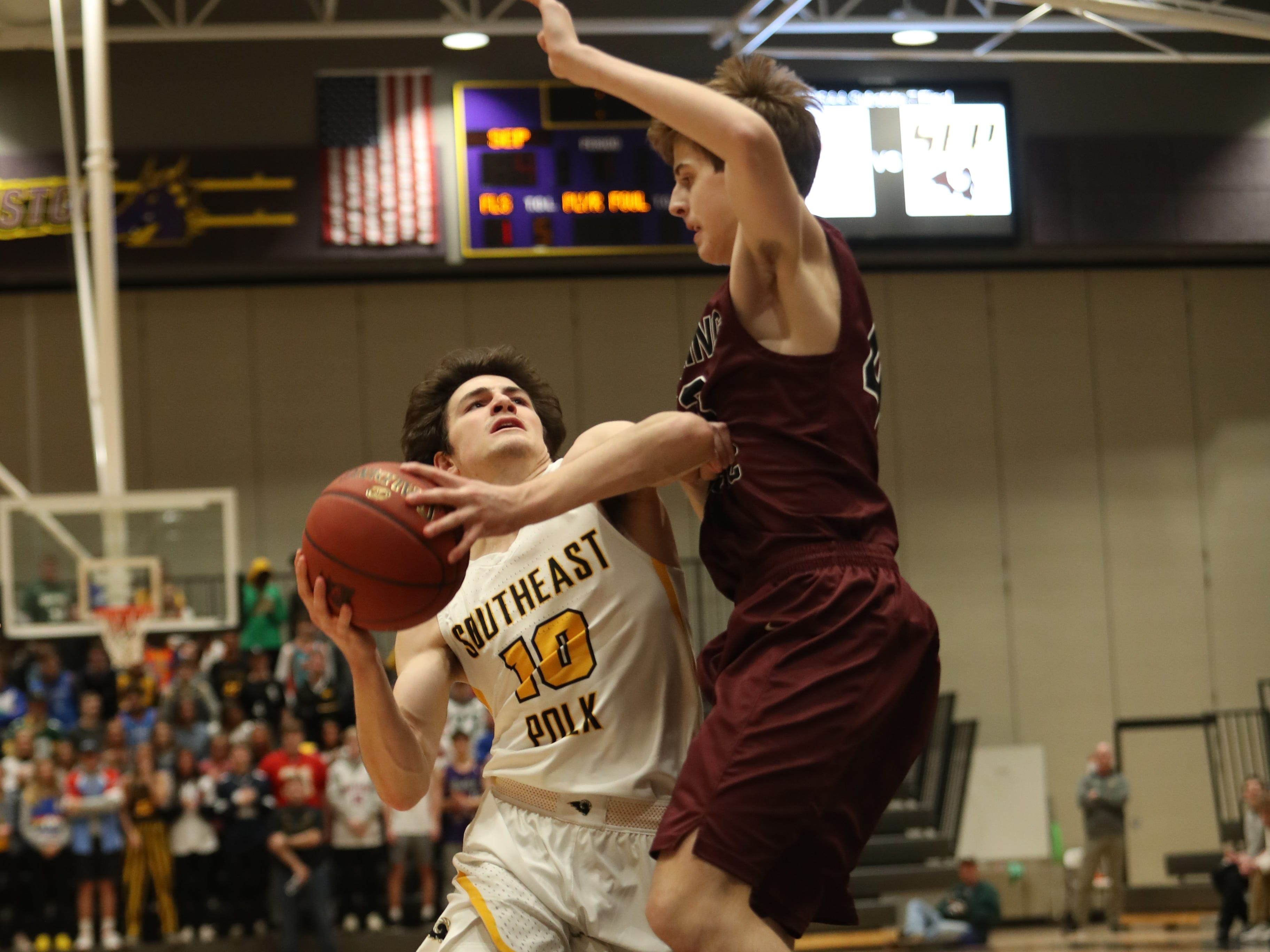 Southeast Polk's Daniel Hackbarth (10) drives the basket against the Dowling Catholic during their game at Johnston High School in Johnston, Iowa, on Tuesday, Feb. 26, 2019. Dowling won the game 44-40 to advance to state.