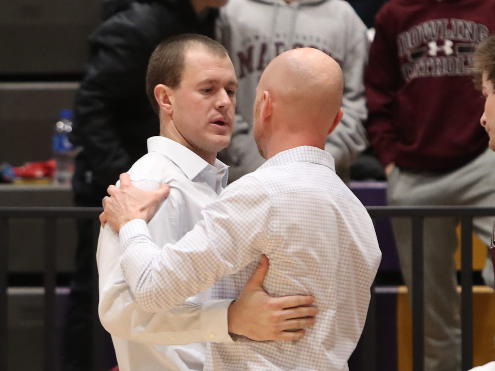 Southeast Polk head coach Alan Jenkins talks to Dowling Catholic head coach Mike O'Connor after the game at Johnston High School in Johnston, Iowa, on Tuesday, Feb. 26, 2019. Dowling won the game 44-40 to advance to state.