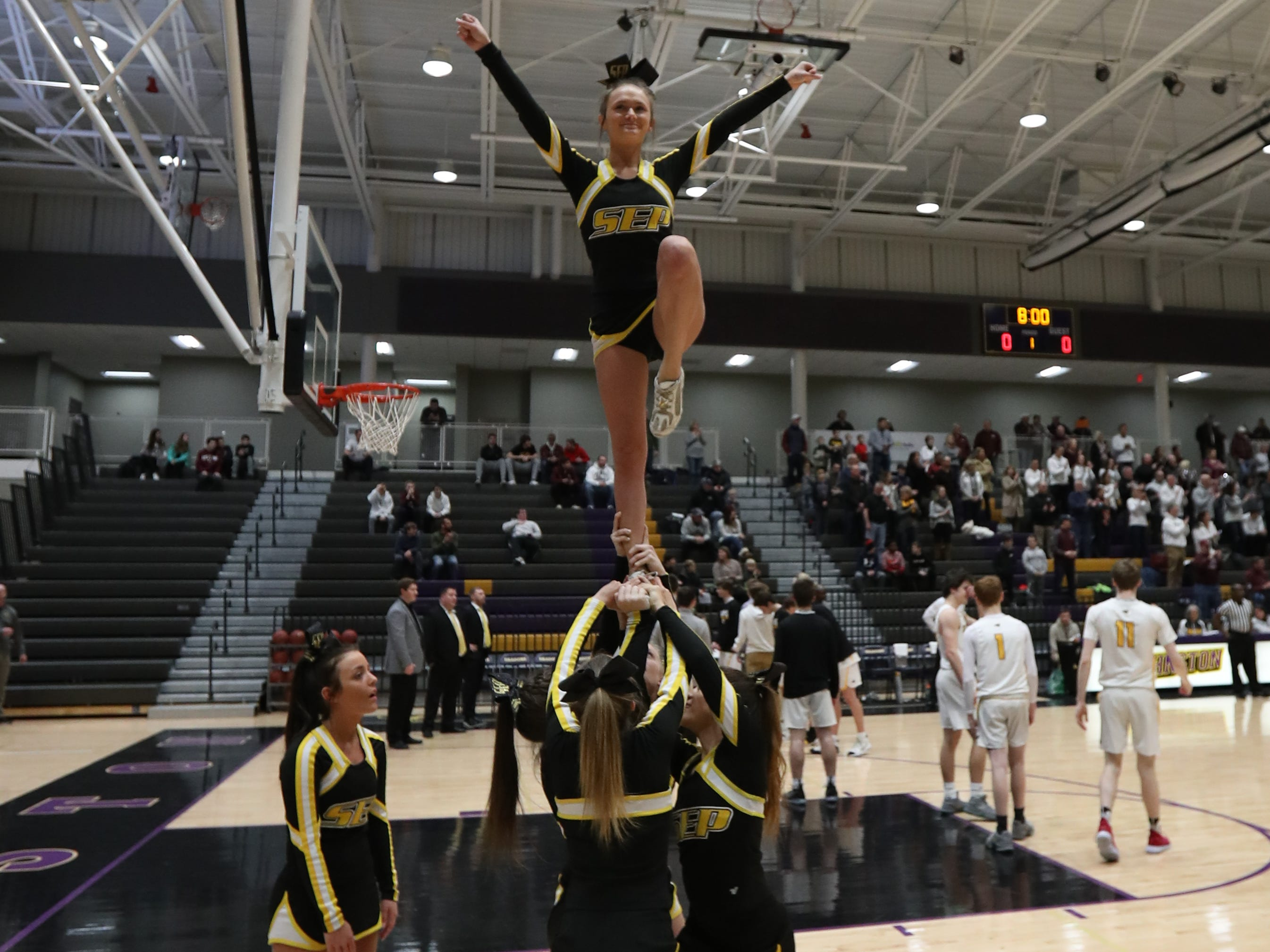 The Southeast Polk cheer squad lead the crowd in cheers against Dowling Catholic during their game at Johnston High School in Johnston, Iowa, on Tuesday, Feb. 26, 2019. Dowling won the game 44-40 to advance to state.