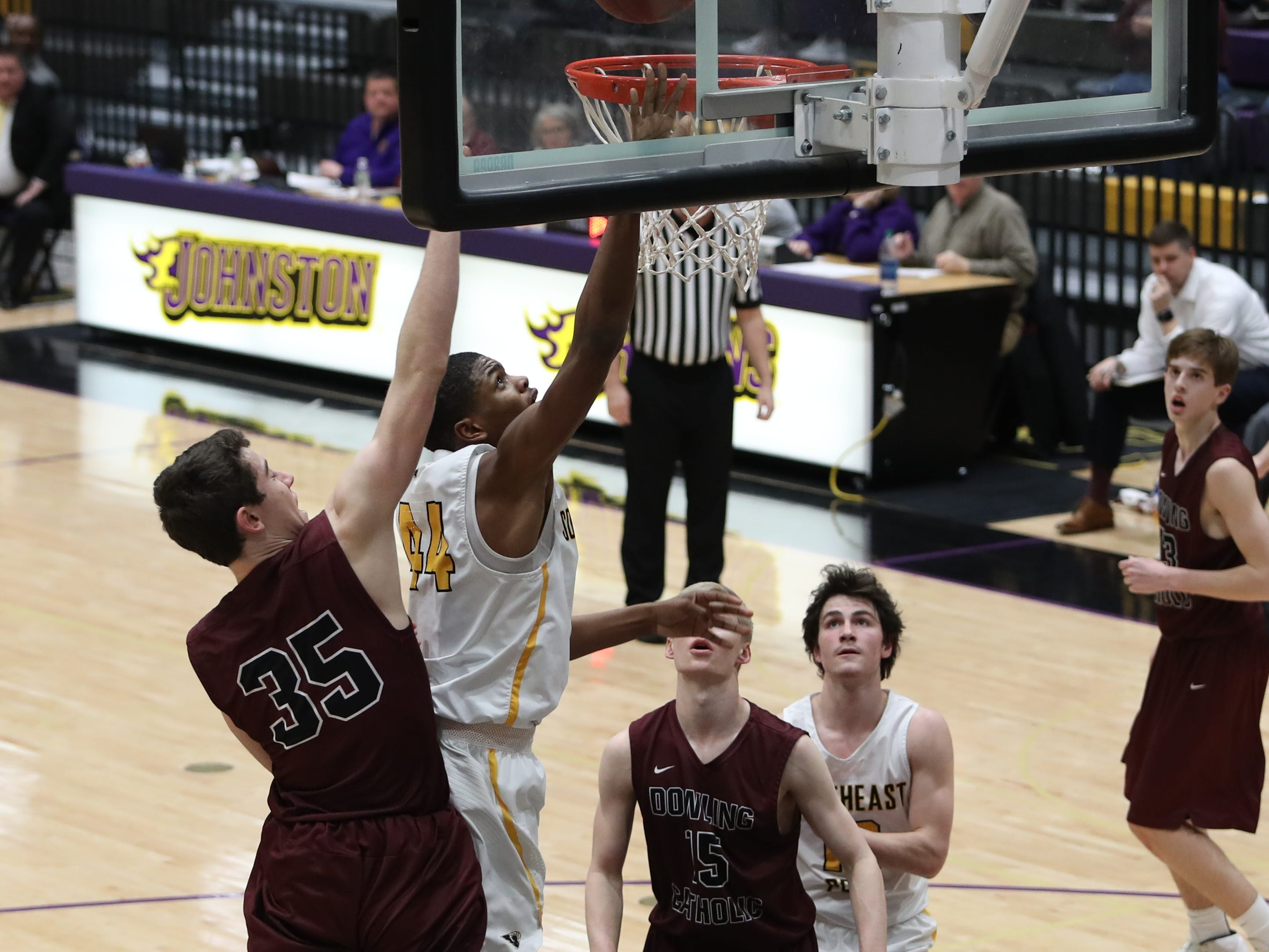 Southeast Polk's Malichai Williams (44) shoots and scores in front of Dowling Catholic's Andrew Lentsch (35) during their game at Johnston High School in Johnston, Iowa, on Tuesday, Feb. 26, 2019. Dowling won the game 44-40 to advance to state.