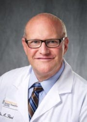 Dr. Alan Reed, who heads the University of Iowa Hospitals and Clinics' Transplant Center