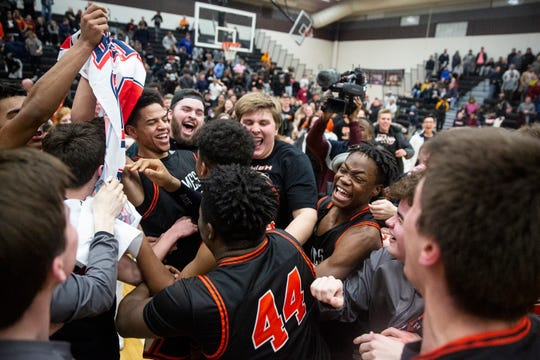 The Ames basketball team celebrates winning the boy's substate final between Ames and North High School on Tuesday, Feb. 26, 2019, in Ankeny.