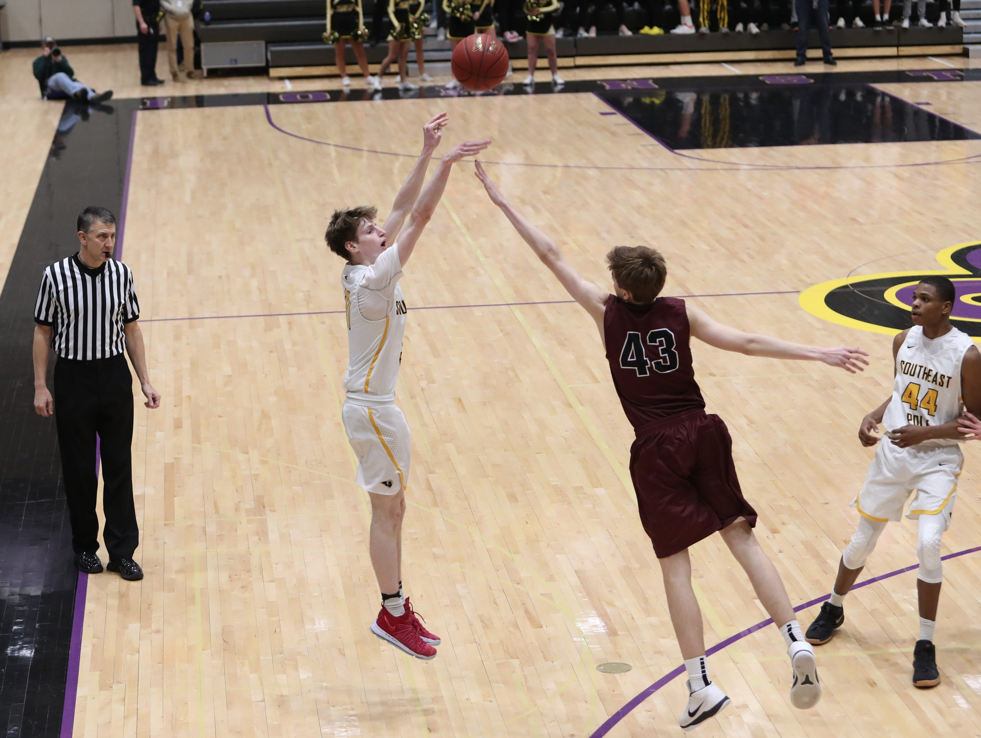 Southeast Polk's Sam Glenn (11) shoots over Dowling Catholic's Drew Daniel (43) during their game at Johnston High School in Johnston, Iowa, on Tuesday, Feb. 26, 2019. Dowling won the game 44-40 to advance to state.