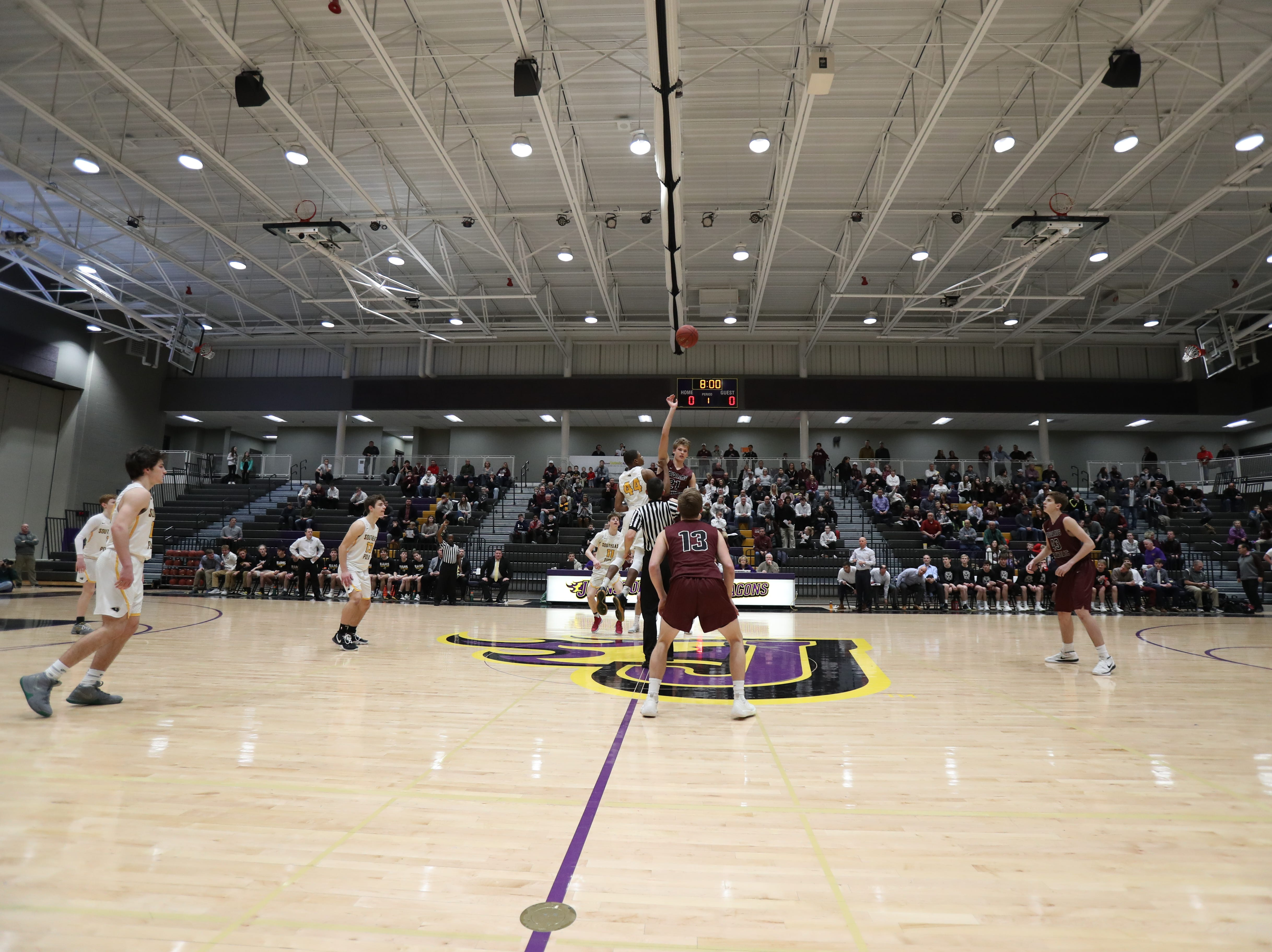 Dowling Catholic's Ryan Riggs (21) wins the jump to start the game against the Southeast Polk at Johnston High School in Johnston, Iowa, on Tuesday, Feb. 26, 2019. Dowling won the game 44-40 to advance to state.