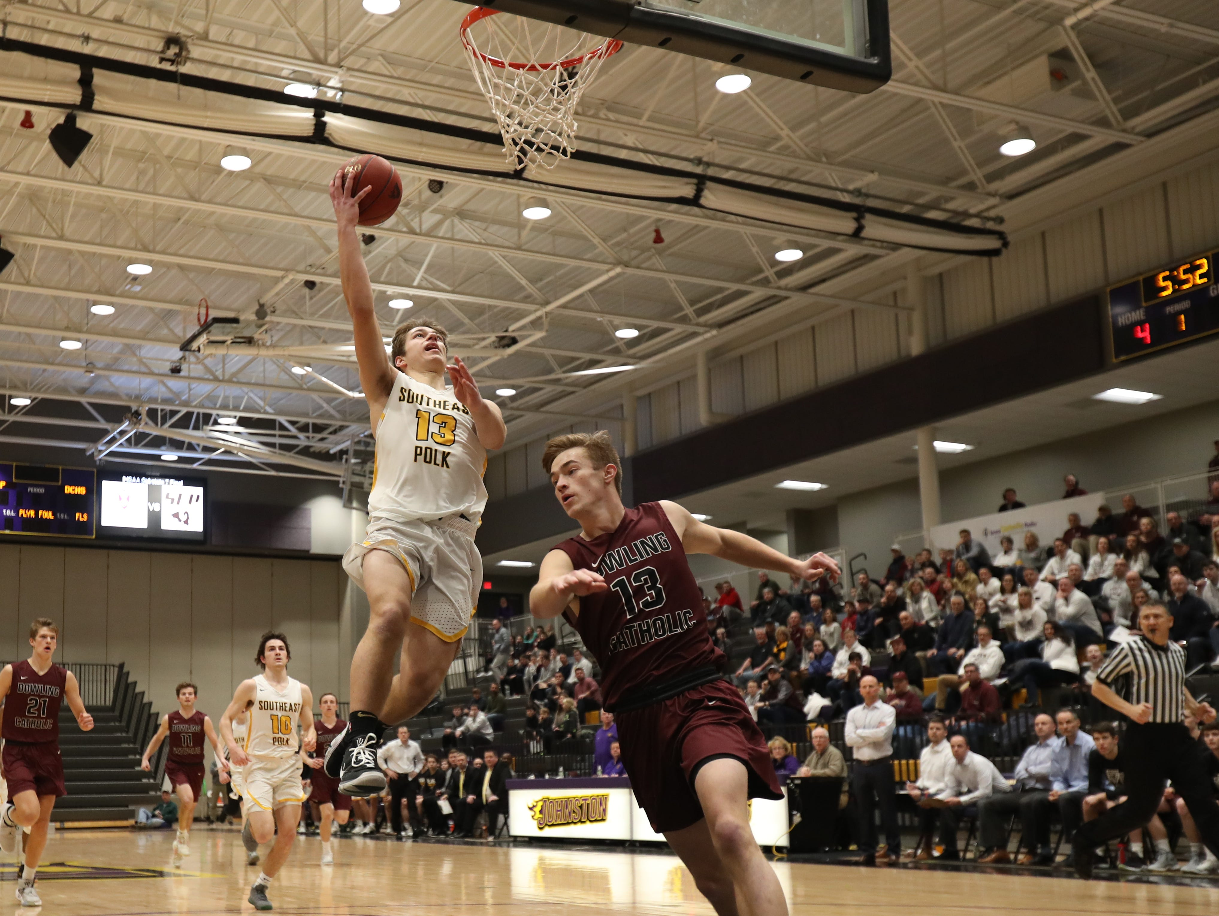 Southeast Polk's Dominic Caggiano (13) beats Dowling Catholic's Jack Lyman (13) to the basket during their game at Johnston High School in Johnston, Iowa, on Tuesday, Feb. 26, 2019. Dowling won the game 44-40 to advance to state.
