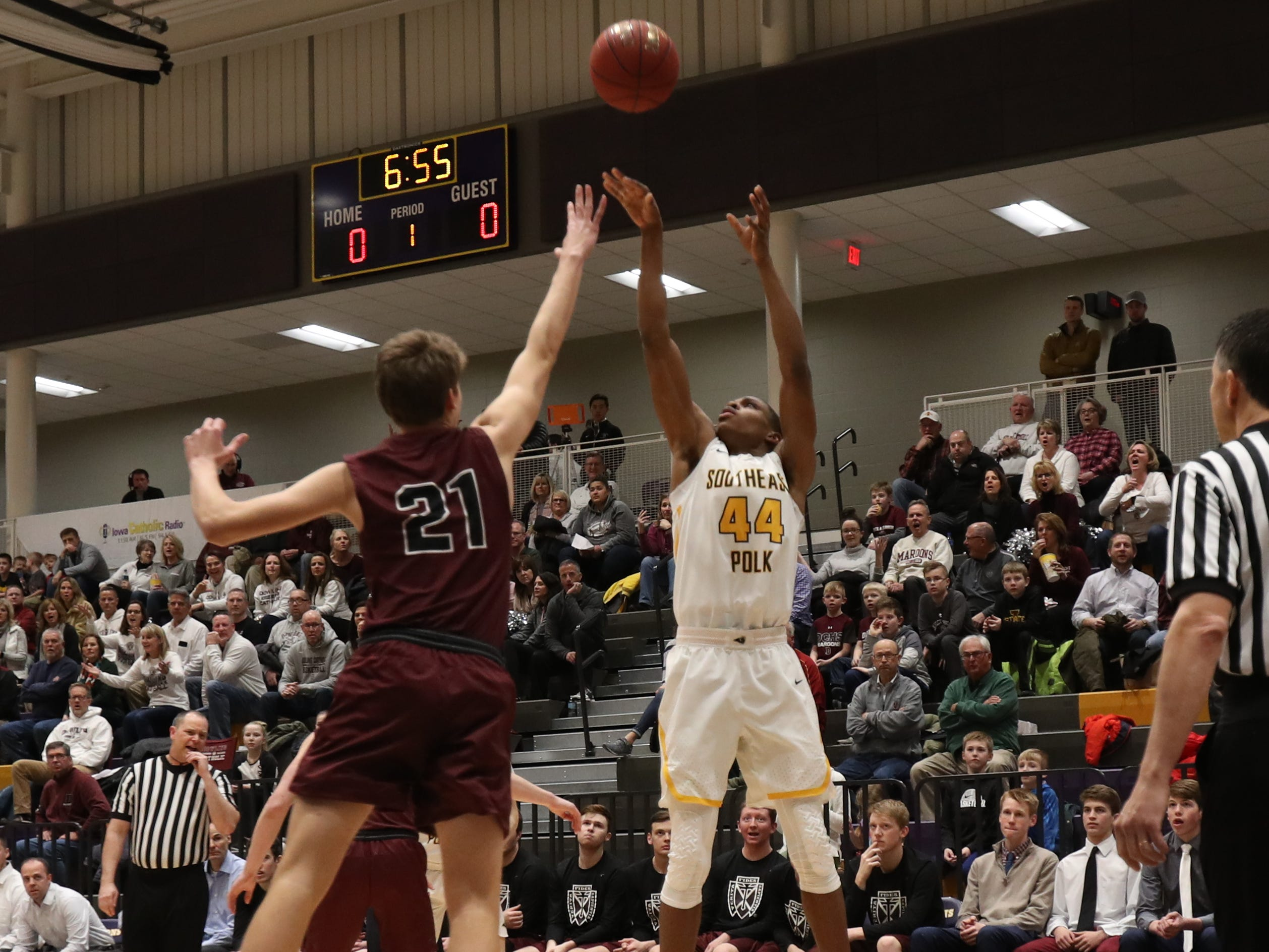 Southeast Polk's Malichai Williams (44) shoots over the arm of Dowling Catholic's Ryan Riggs (21) during their game at Johnston High School in Johnston, Iowa, on Tuesday, Feb. 26, 2019. Dowling won the game 44-40 to advance to state.