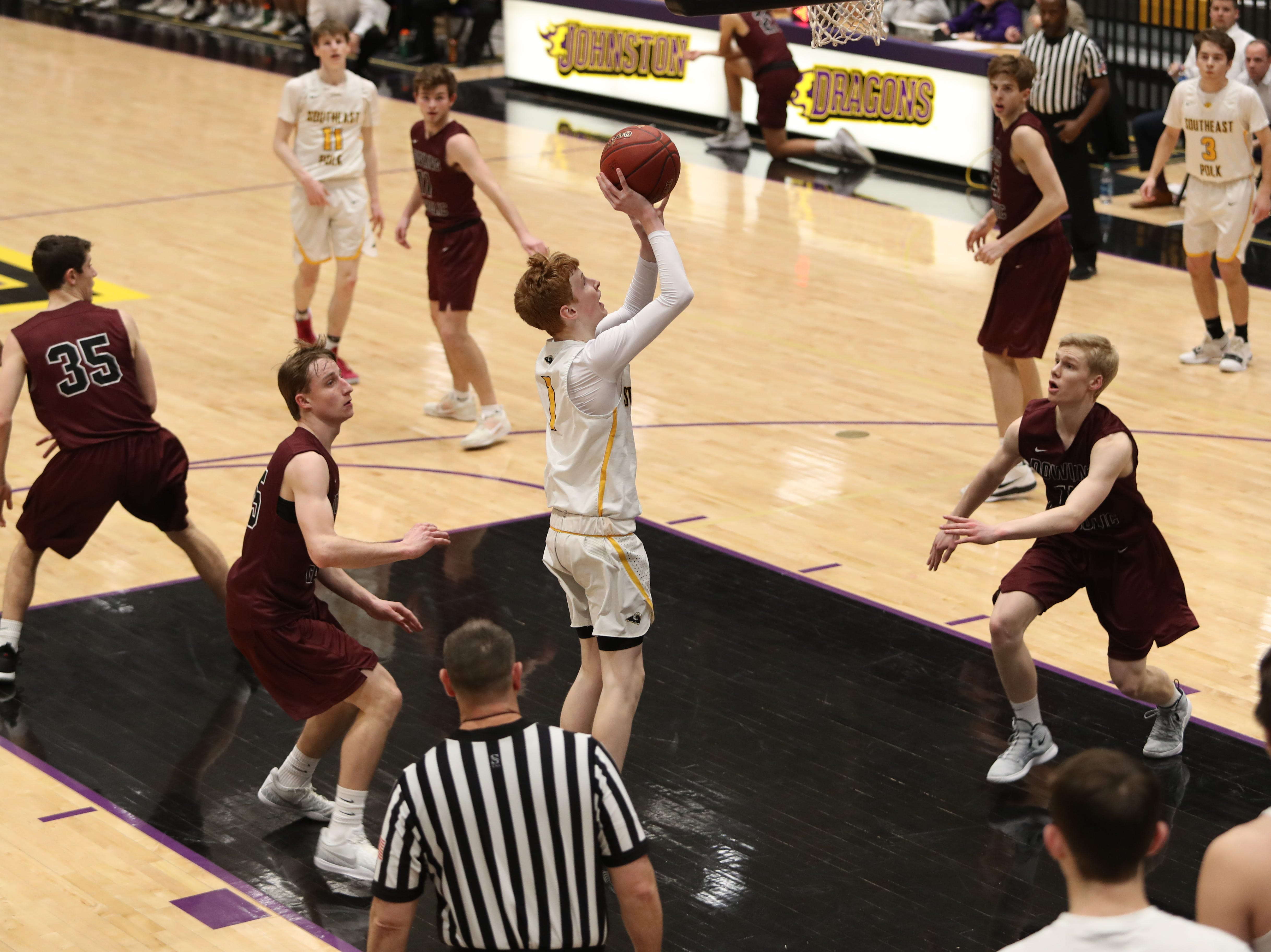 Southeast Polk's James Glenn (1) shoots and scores against Dowling Catholic during their game at Johnston High School in Johnston, Iowa, on Tuesday, Feb. 26, 2019. Dowling won the game 44-40 to advance to state.