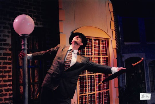 "A 1996 Des Moines Community Playhouse photo of ""Singin' In The Rain."""