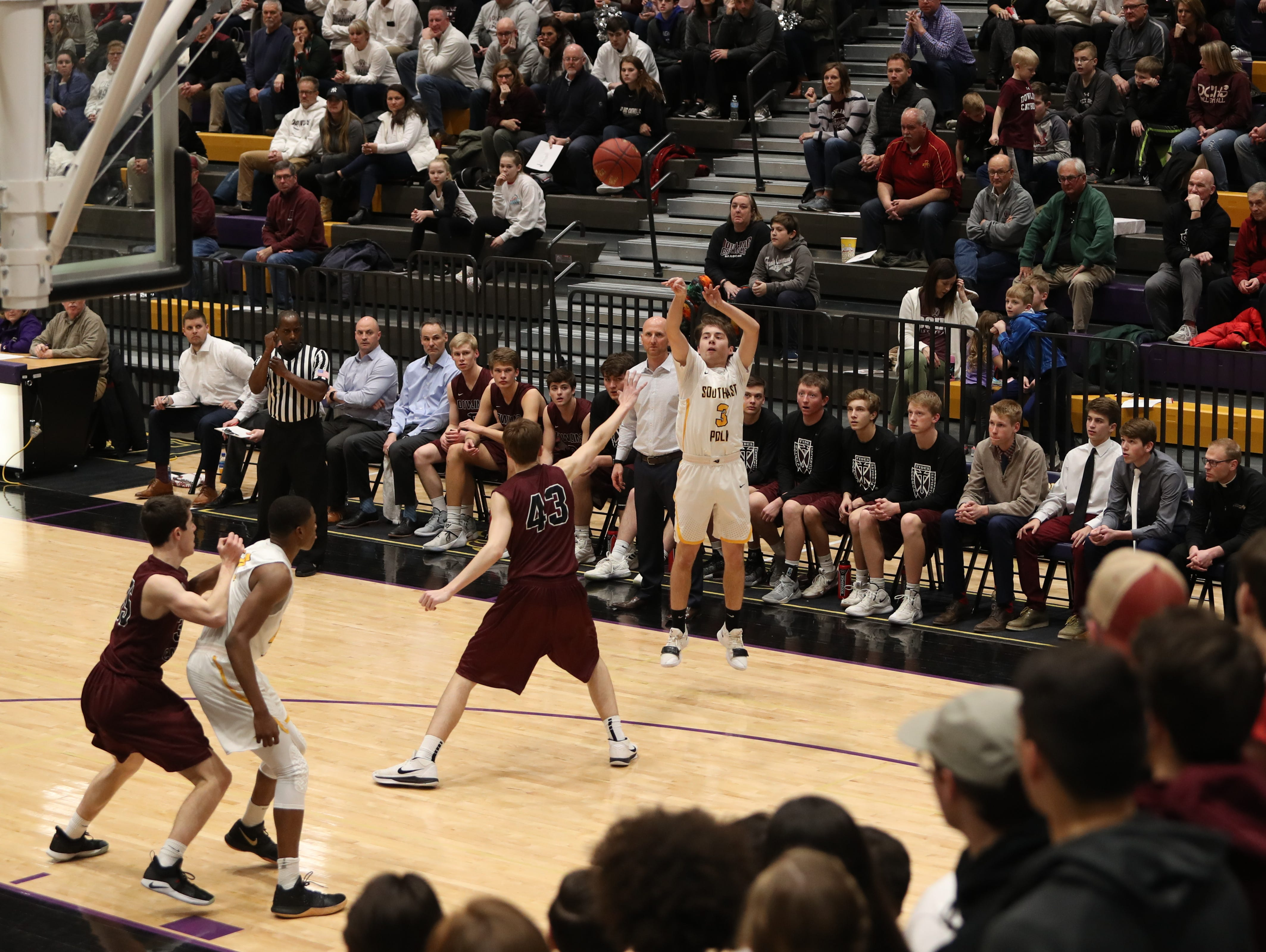 Southeast Polk's Kaleb Krier (3) shoots from the outside against the Dowling Catholic during their game at Johnston High School in Johnston, Iowa, on Tuesday, Feb. 26, 2019. Dowling won the game 44-40 to advance to state.
