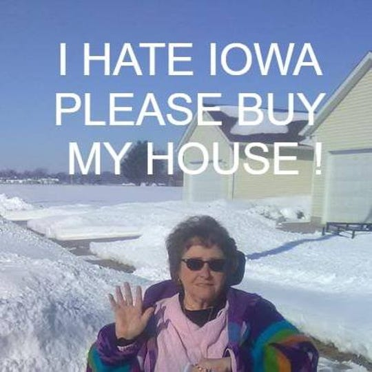 In this Facebook profile photo gone viral, Vinton resident Wendy Lange makes her feelings about the state and her desire to sell her house clear.