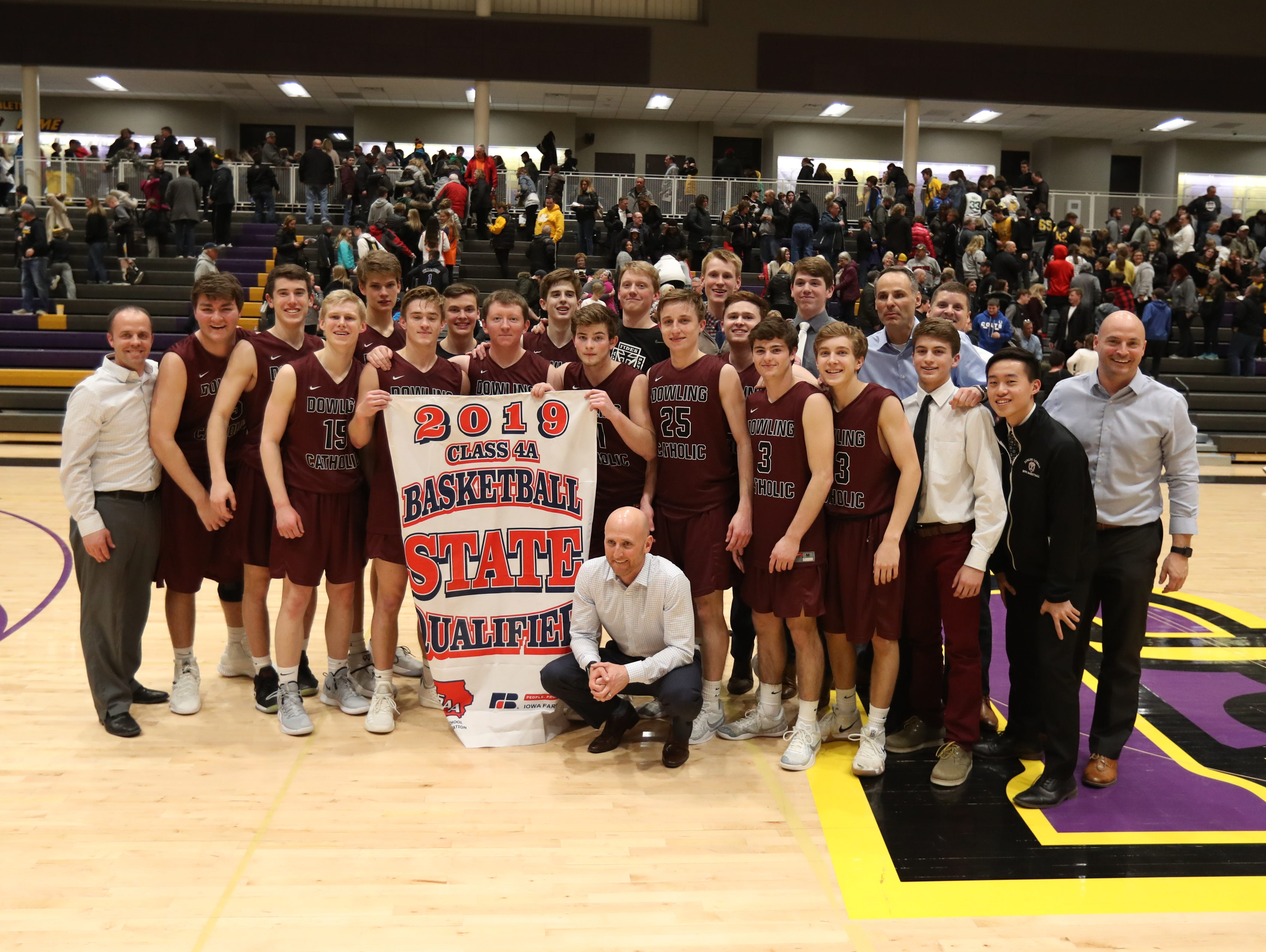Dowling Catholic players gather after qualifying for the 2019 state basketball tournament after beating Southeast Polk at Johnston High School in Johnston, Iowa, on Tuesday, Feb. 26, 2019.