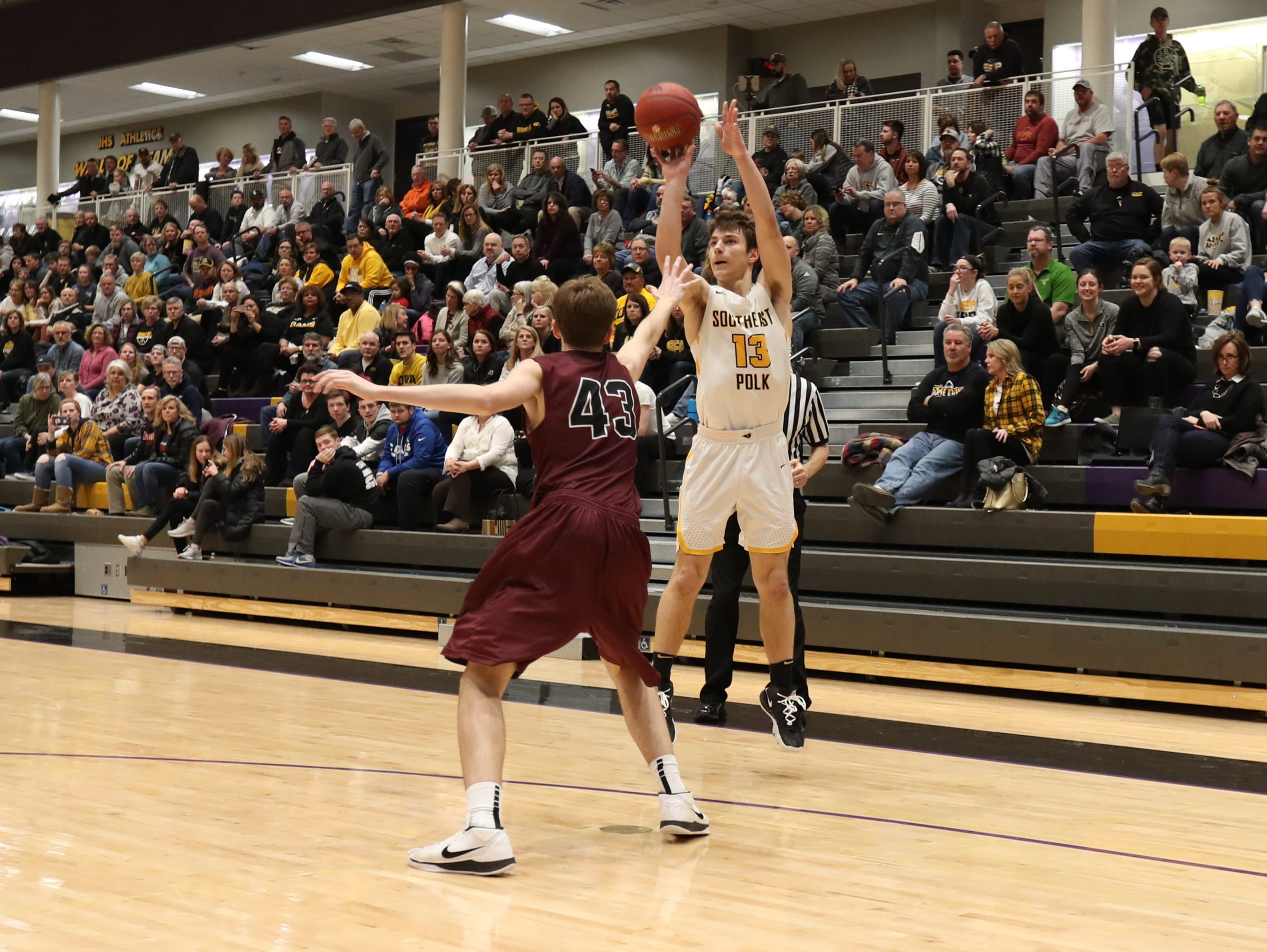 Southeast Polk's Dominic Caggiano (13) shoots over the top of Dowling Catholic's Drew Daniel (43) during their game at Johnston High School in Johnston, Iowa, on Tuesday, Feb. 26, 2019. Dowling won the game 44-40 to advance to state.
