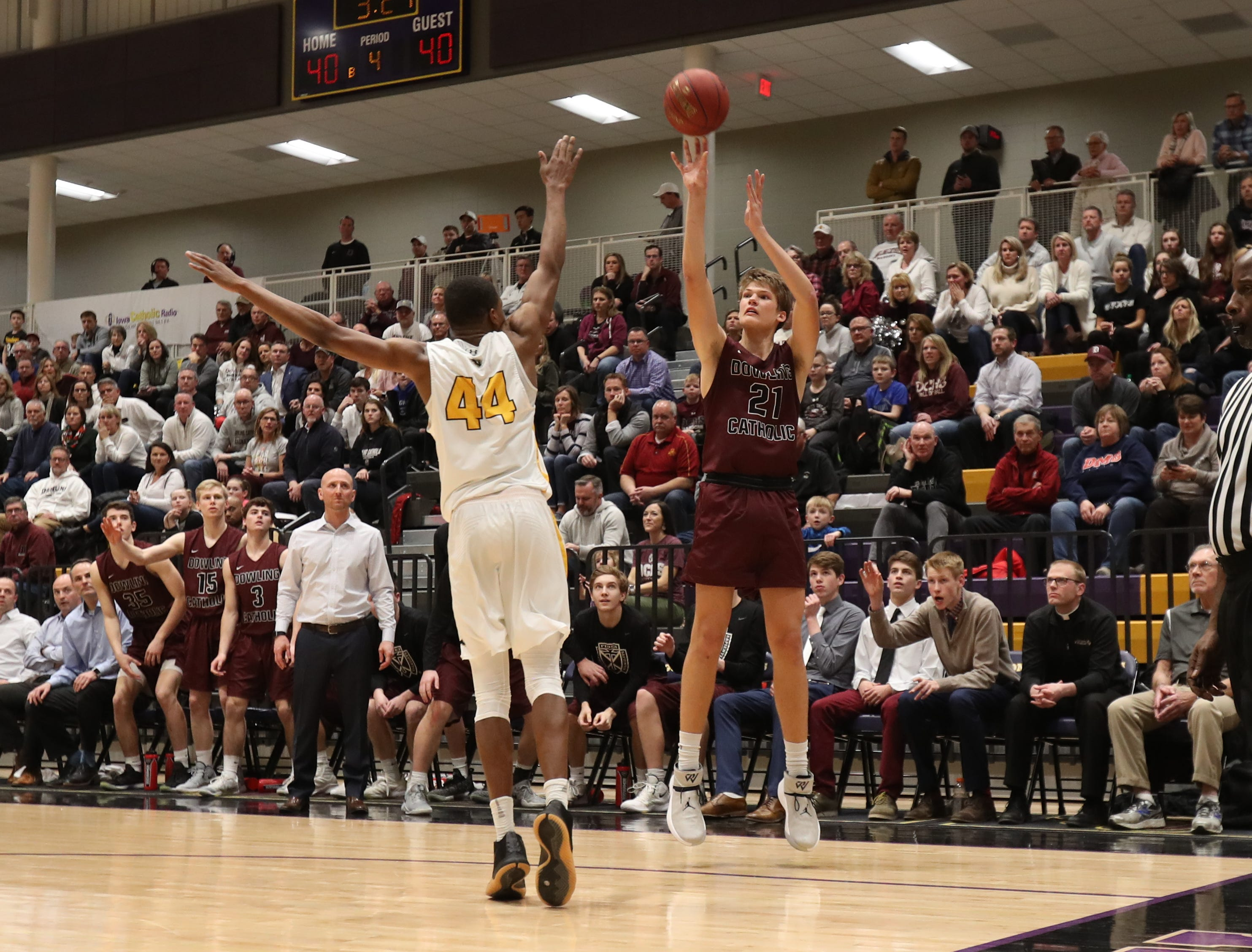 Dowling Catholic's Ryan Riggs (21) shoots over Southeast Polk's Malichai Williams (44) during their game at Johnston High School in Johnston, Iowa, on Tuesday, Feb. 26, 2019. Dowling won the game 44-40 to advance to state.