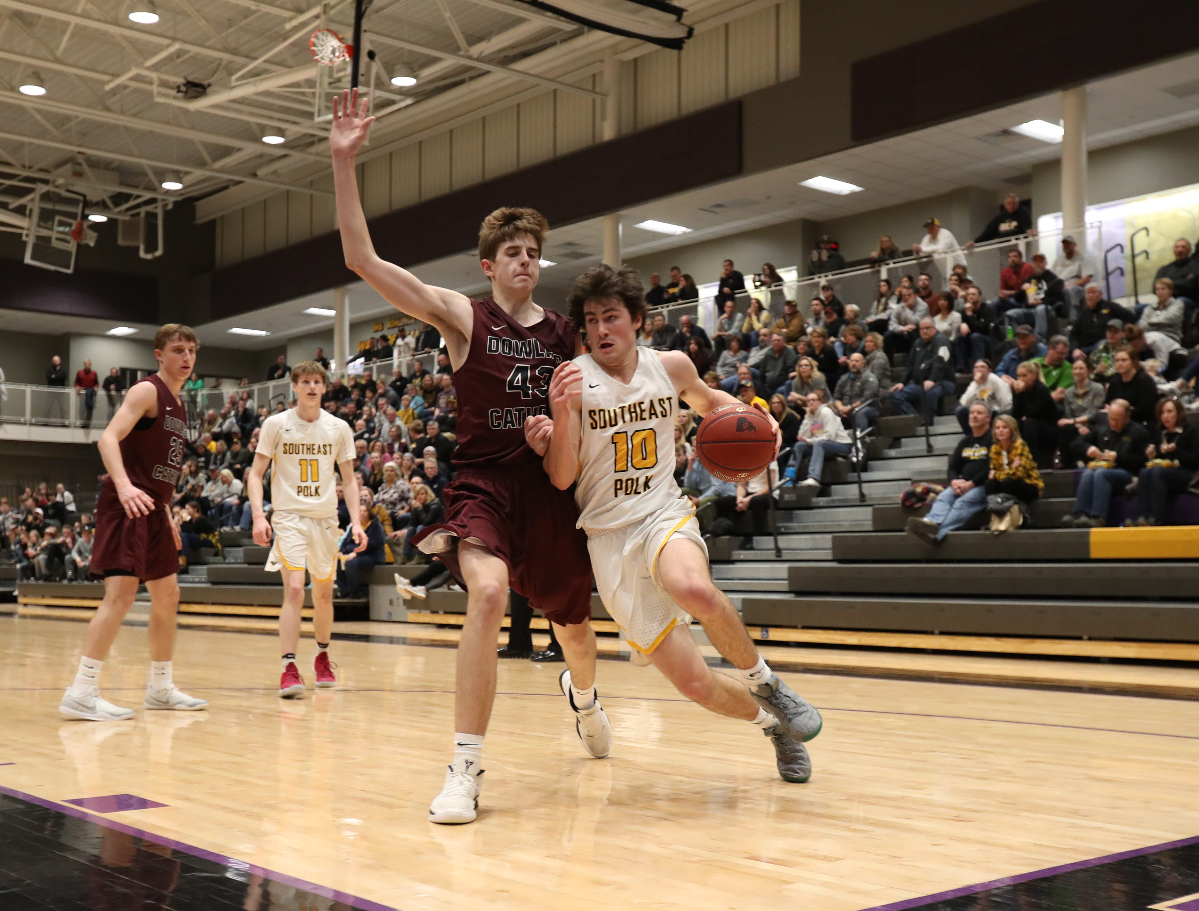 Southeast Polk's Daniel Hackbarth (10) drives baseline past Dowling Catholic's Drew Daniel (43) during their game at Johnston High School in Johnston, Iowa, on Tuesday, Feb. 26, 2019. Dowling won the game 44-40 to advance to state.