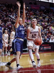 Grundy Center senior Hailey Wallis runs up a shot around Unity Christian's Brooke Zevenbergen in their Class 2A quarterfinal game on Tuesday, Feb. 26, 2019, at Wells Fargo Arena in Des Moines.