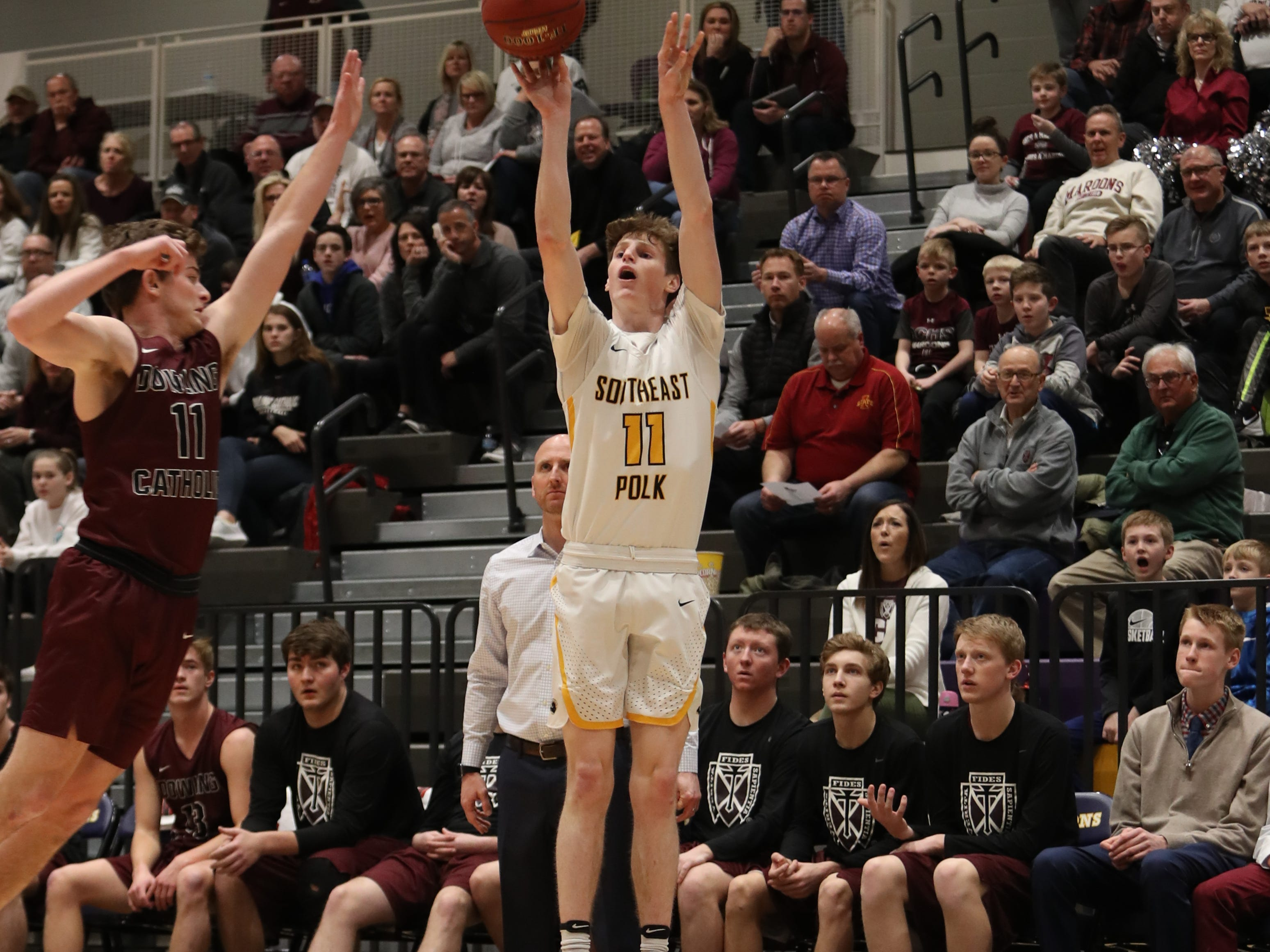 Southeast Polk's Sam Glenn (11) shoots against Dowling Catholic during their game at Johnston High School in Johnston, Iowa, on Tuesday, Feb. 26, 2019. Dowling won the game 44-40 to advance to state.