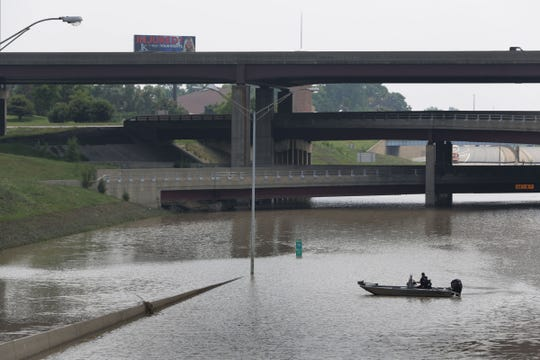 A Michigan State Police boat patrols on I-75 at I-696 on Tuesday August 12, 2014. It was the second-heaviest single day rainfall in Michigan history, with 4.57 inches recorded at Detroit Metro Airport. The record is 4.74 on July 31, 1925.