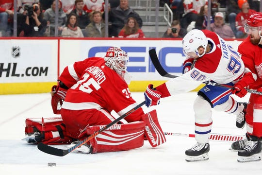 Montreal Canadiens left wing Tomas Tatar (90) scores a goal against Detroit Red Wings goaltender Jimmy Howard (35) during the first period at Little Caesars Arena on Feb. 26, 2019.
