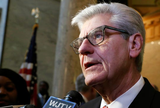 In this Wednesday Jan. 30, 2019, file photo, Gov. Phil Bryant speaks to reporters at the Capitol in Jackson, Miss. A Michigan man has been arrested on charges that he made death threats to Bryant in January.