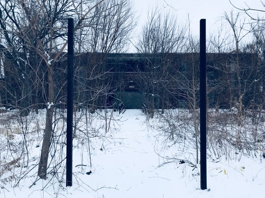 This burned-out structure on East Grand Boulevard in Detroit sits across the street from the Davenport Center, a youth center that's accused of putting troubled and neglected girls in harms way.