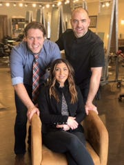 R. Collective, which has a salon in Clawson, is opening a second location in Birmingham. Pictured are co-owners, from left, Tony Raymaker, Amanda Raymaker and Scott Raymaker.