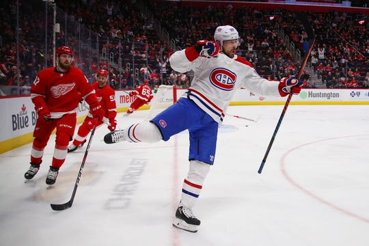 Tomas Tatar #90 of the Montreal Canadiens celebrates his first period goal next to Filip Hronek #17 of the Detroit Red Wings at Little Caesars Arena on February 26, 2019 in Detroit, Michigan.