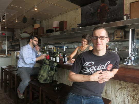 Chef-owner James Rigato pauses at the bar of his new Hazel Park restaurant, Mabel Gray.