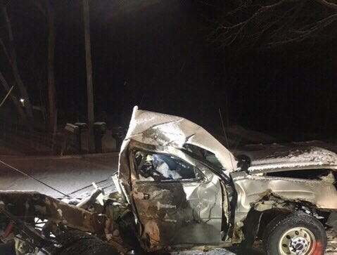 What remains of the vehicle that hit a tree on Grange Hall Road in Groveland Township.