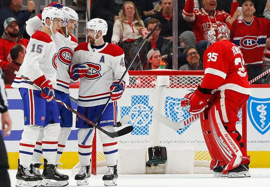 Montreal Canadiens right wing Joel Armia, second from left, celebrates his goal against the Detroit Red Wings in the second period of an NHL hockey game, Tuesday, Feb. 26, 2019, in Detroit.