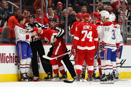 Montreal Canadiens defenseman Brett Kulak (17) and Detroit Red Wings center Dylan Larkin (71) get into a fight during the third period at Little Caesars Arena on Feb. 26, 2019.