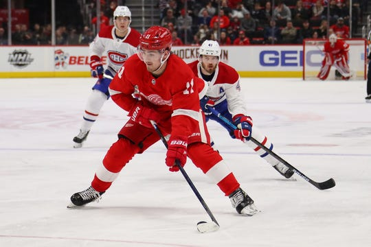 Filip Zadina #11 of the Detroit Red Wings heads up ice in front of Paul Byron #41 of the Montreal Canadiens during the third period at Little Caesars Arena on February 26, 2019 in Detroit, Michigan.