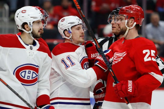 Montreal Canadiens right wing Brendan Gallagher (11) and Detroit Red Wings defenseman Mike Green (25) shove each other during the third period at Little Caesars Arena on Feb. 26, 2019.