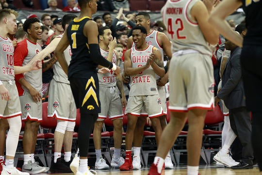 Ohio State Buckeyes celebrate their 90-70 win over Iowa Hawkeyes.