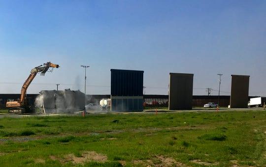 Work crews begin to demolish border wall prototypes in San Diego on Wednesday, Feb. 27, 2019.