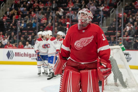 Detroit goaltender Jimmy Howard looks away as Montreal celebrates a goal by center Andrew Shaw in the second period.