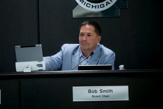 Commissioner Bob Smith, brother of Eric Smith, attends a meeting of the Macomb County Board of Commissioners in Mt. Clemens Wednesday.