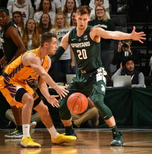 Michigan State guard Matt McQuaid has established himself this season as one of the Big Ten's best defenders.
