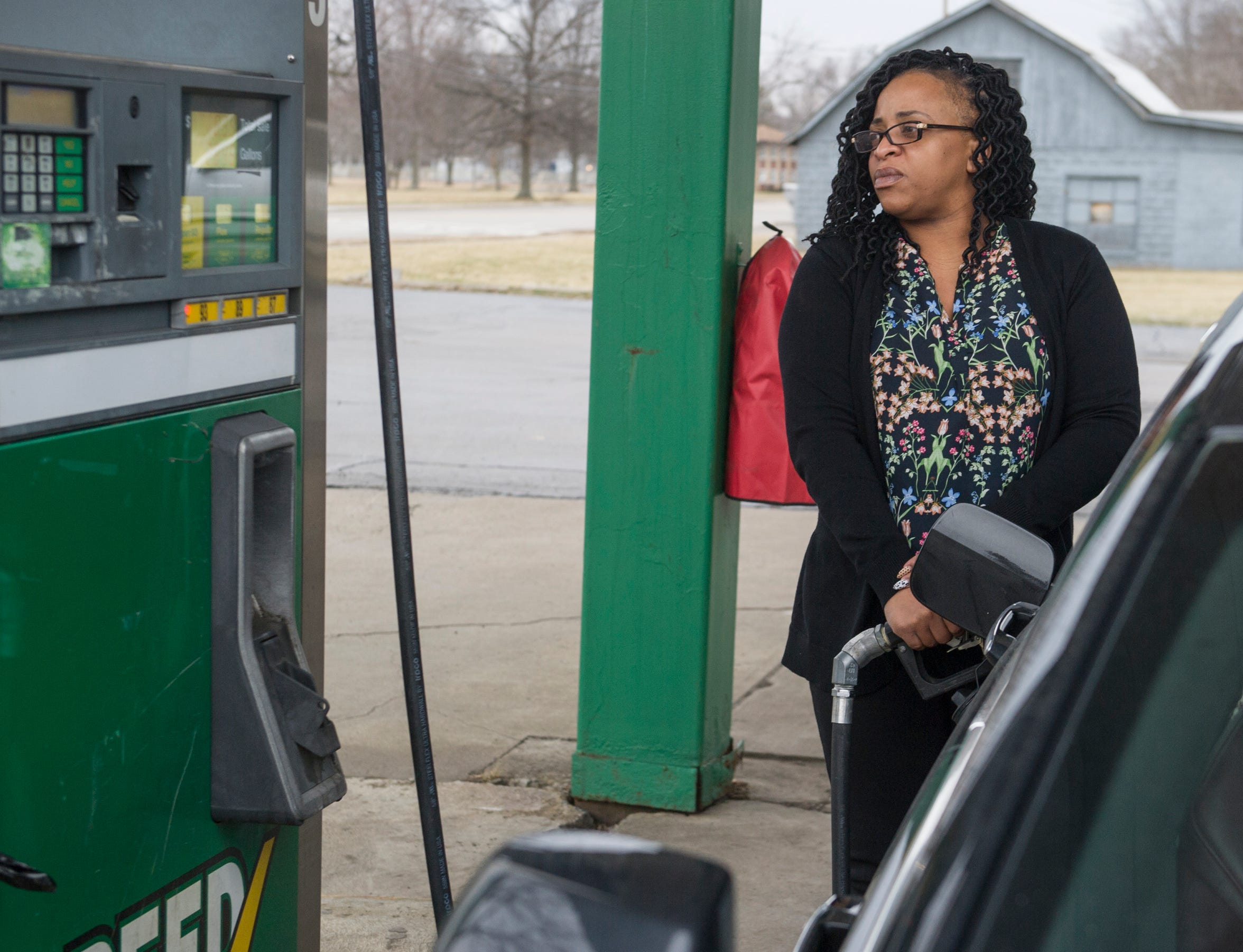 Erica Royster of Warren, Ohio, pumps gas  near the GM Lordstown plant. Royster was laid off from the MAGNA Seating Systems plant in Lordstown, a supplier to the GM plant.