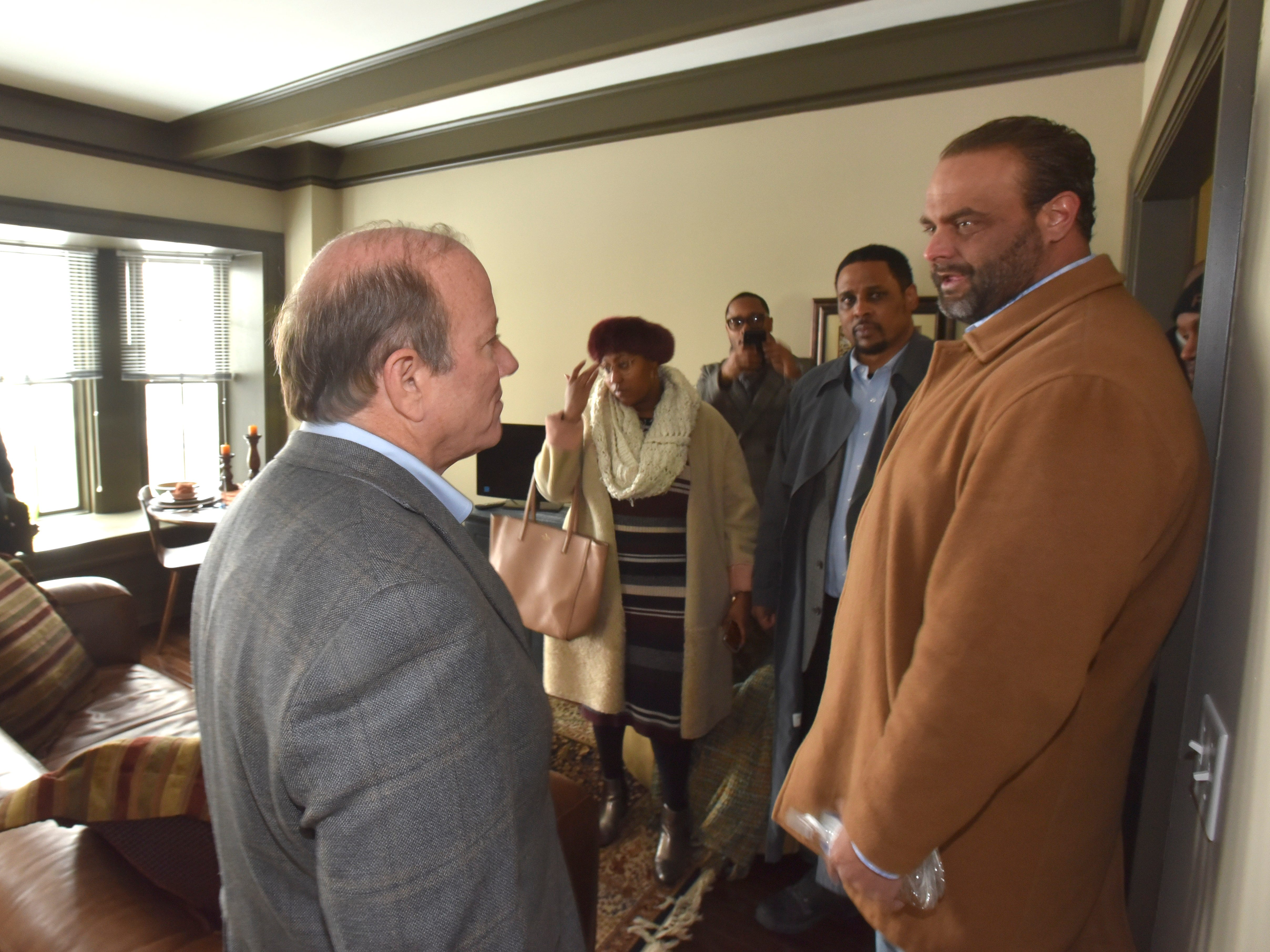 Detroit Mayor Mike Duggan, left, talks with CCIH President and CEO Ryan Lepper, right, in one of the finished apartments.