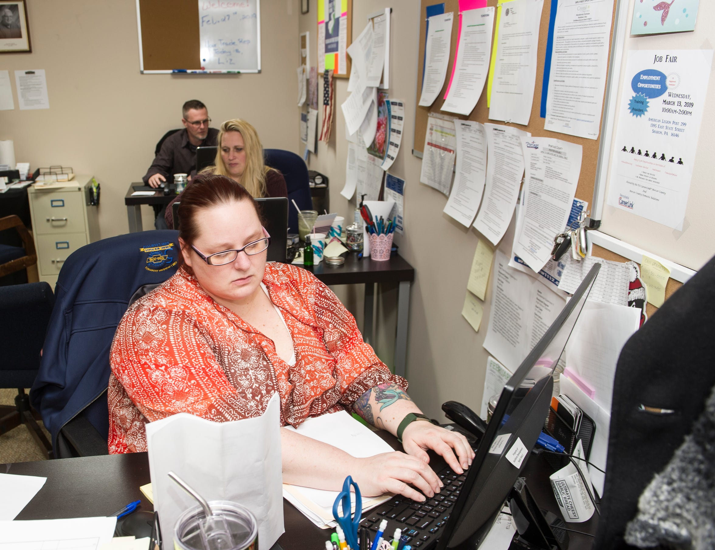 Trisha Amato of Poland, Ohio, types in the resume of a GM worker at the UAW Local 1112 Transition Center near the GM Lordstown plant on Wednesday, Feb. 27.