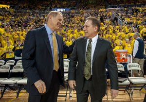 Michigan's John Beilein (left) and Michigan State's Tom Izzo (right) are among 15 finalists for the Naismith coach of the year award, which was released on Wednesday.