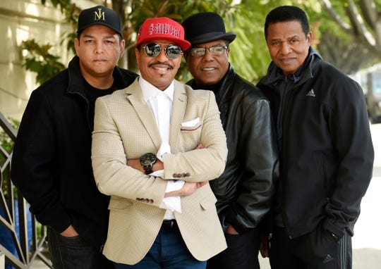 Marlon Jackson, second from left, Tito Jackson, second from right, and Jackie Jackson, far right, brothers of the late musical artist Michael Jackson, and Tito's son Taj, far left, pose together for a portrait outside the Four Seasons Hotel, in Los Angeles.