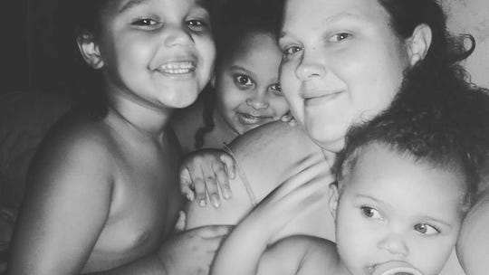 Mother Krystal Whitney, 29, with three of her five children.