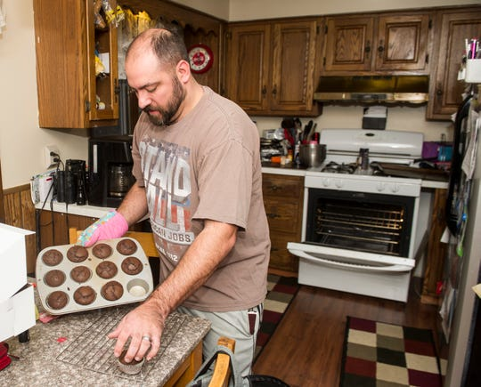 Brian Milo of Warren, Ohio, makes cupcakes for his 5-year-old daughter on Wednesday, Feb. 27. Milo was laid off from the GM Lordstown plant in June, and is now studying at a local trade school.