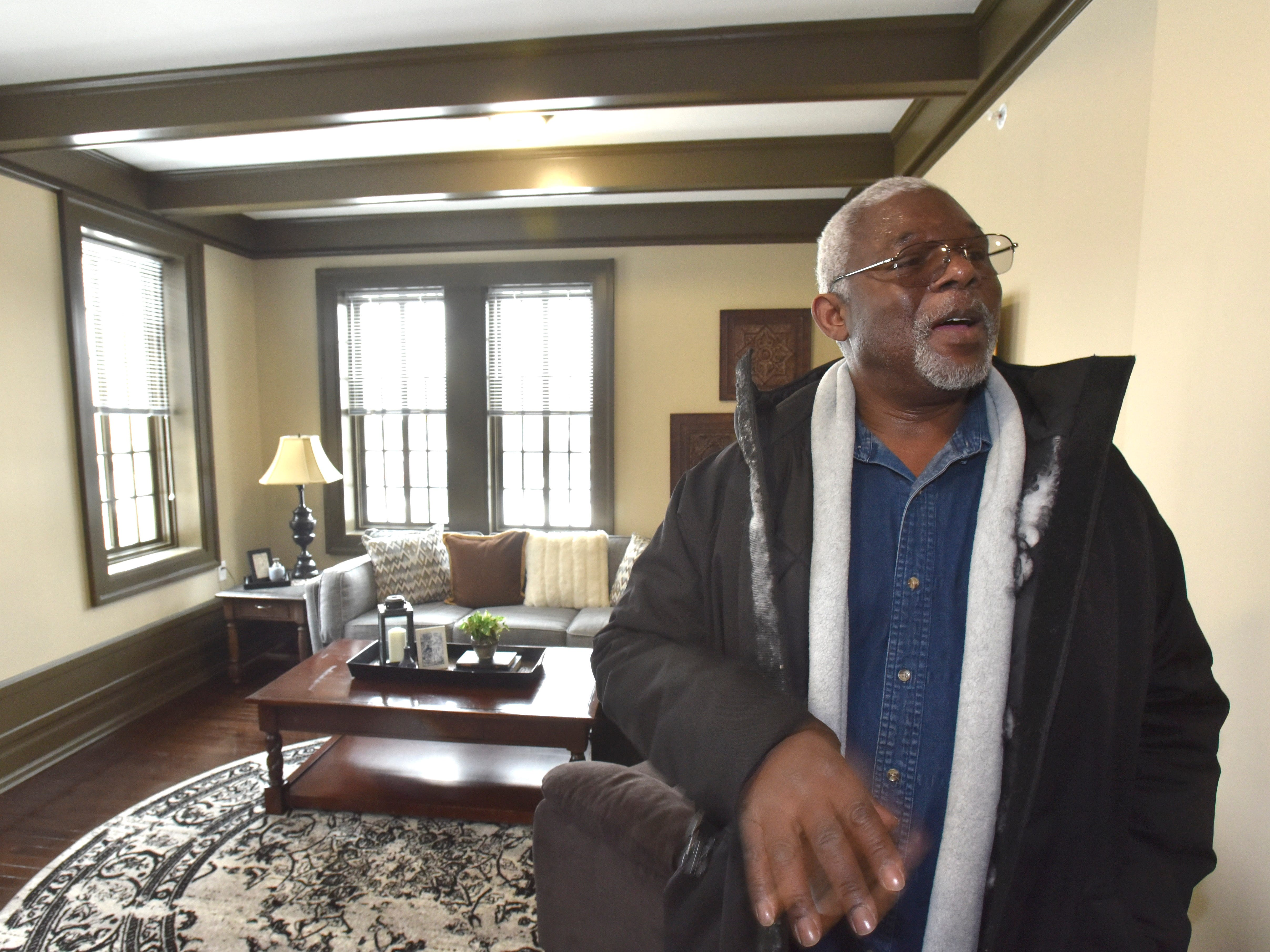 Retired U.S. Army truck driver Nathaniel Smith talks to a journalist in a finished apartment. He will move into another apartment in the future.