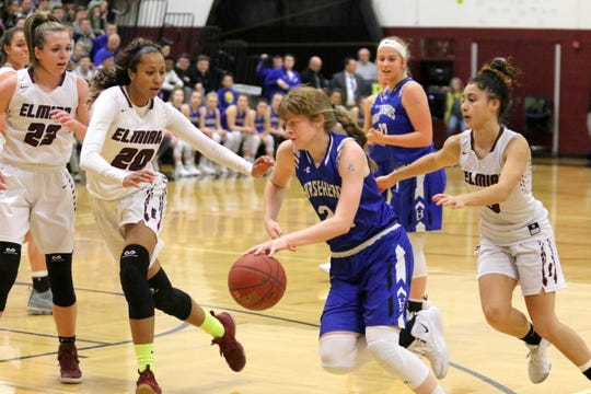 Jillian Casey of Horseheads drives to her left as Elmira's Zaria DeMember-Shazer (20) and Zhane Holmes defend during a Section 4 Class AA girls basketball semifinal Feb. 26, 2019 at Elmira High School.